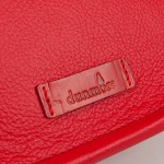 Detail of Strathearn saddle bag showing the leather Dunmore logo tag
