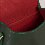 Red suede lining in green leather saddlebag