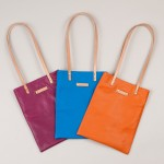 Three of the brightly coloured Iona leather tote bags