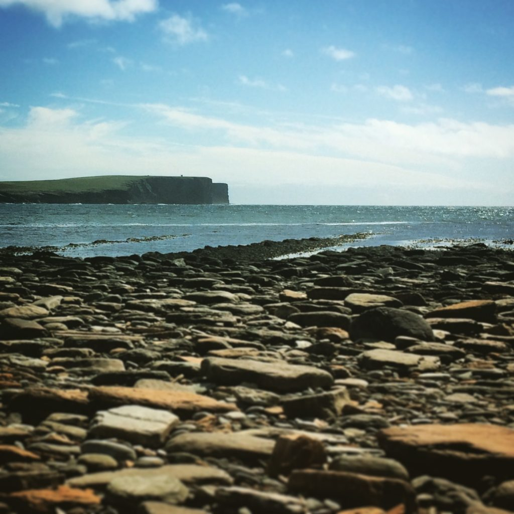 The cliffs of Marwick Head in Orkney, seen from the rocky beach at the Brough of Birsay
